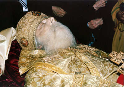 The reposed Clairvoyant Archbishop Andrew in his casket. Fr. Isaac placed his numb arm on the holy archbishop and asked for forgiveness and healing.