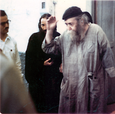 Father Ieronymos, with Father Panteliemon weeping in the background.