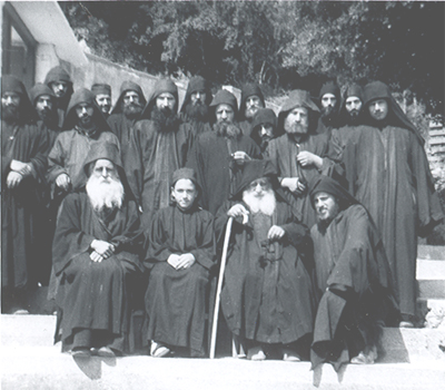Elder Arsenios and the Fathers of New Skete. John Adondakis (Fr. Isaac) is shown on the bottom right.